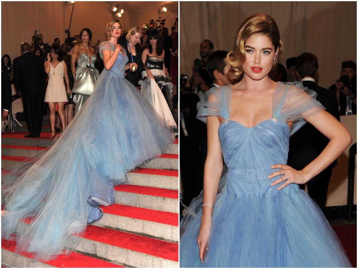 Doutzen Kroes walks into the Met Gala with her dress trailing behind her, 2010.
