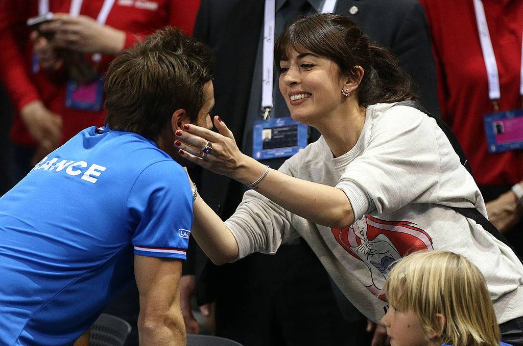 NANCY, FRANCE - APRIL 06: French singer Nolwenn Leroy congratulates her longtime boyfriend french Davis Cup captain Arnaud Clement after the victorious second round Davis Cup match between France and Germany at Palais des Sports Jean Weille stadium on April 6, 2014 in Nancy, France