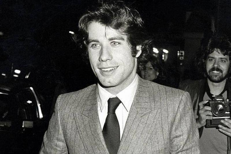 john travolta young smiling