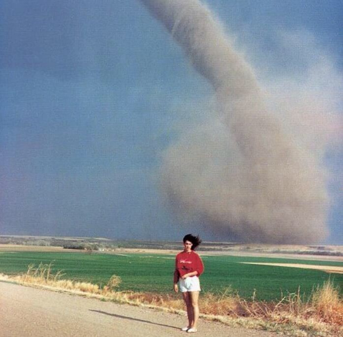 woman with a tornado behind her.jpg